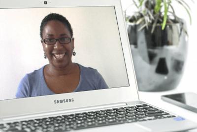 Tutorial instructor Maria Arthur on laptop next to plant